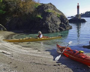 Two kayaks on a midden cove, Pender Island BC