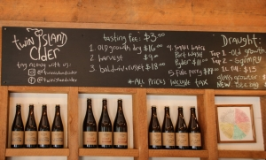 Sign and bottles at Twin Island Cider, Pender Island BC