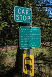 Car stop sign with bus stop sign, Pender Island BC