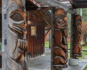 Totems at front of Community Hall on Pender Island.